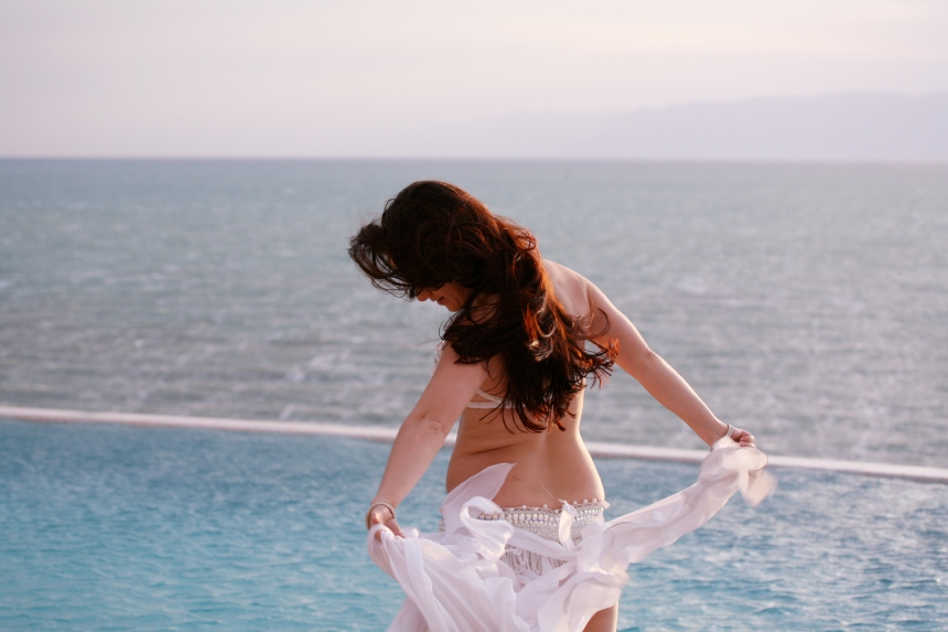 Belly dancer, pool and sea